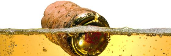 champagne cork sinking in bubbles