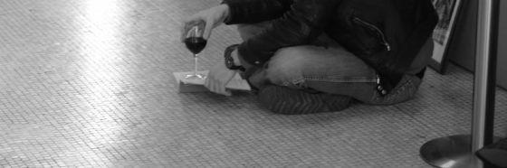 man reading glass wine